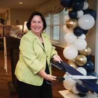 Colleen Frankenfield, President & CEO of Lutheran Social Ministries of New Jersey, cuts the ceremonial ribbon.