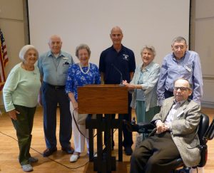 David Black of the West Essex First Aid Squad poses with a group of Crane's Mill residents.