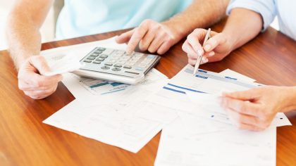 Close up of couple's hands calculating home finances